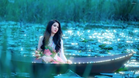 girl-with-flowers-sitting-in-the-boat-53970-1920x1080