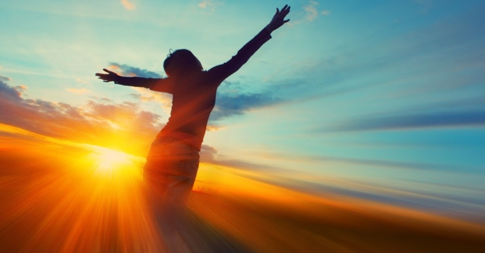 14064-woman-sunset-girl-arms-blue-sky-clouds-silhouette.1200w.tn